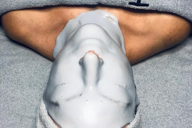 A woman receiving a facial.